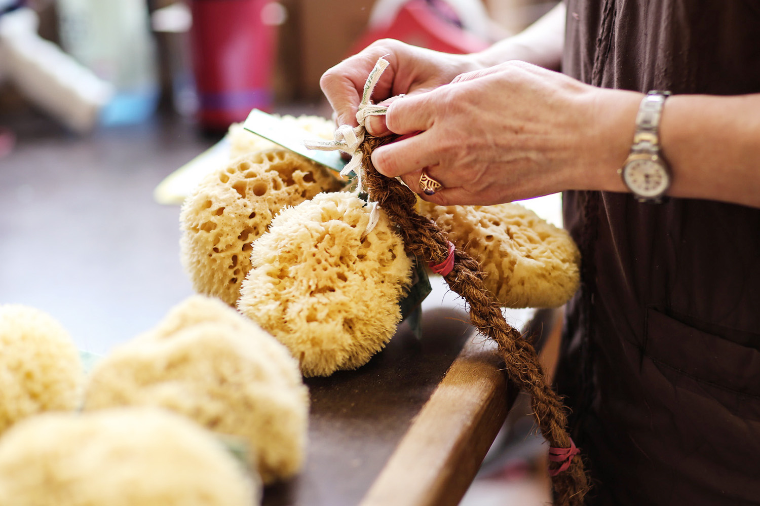 Before a natural sponge is shipped for sale, it goes through many different hands.